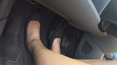 brake : Female legs pushing car pedals starting engine, driving lesson with instructor Stock Footage