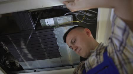 refrigerant : Experienced repairman finds leak in system and skillfully fixing it, maintenance Stock Footage