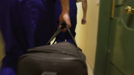 ремонтник : Repair men walking down corridor in apartment building, housing and utility