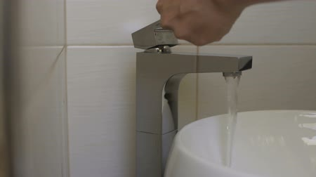 csőhálózat : Owner checking water supply resumption in house after payment of debts, utility