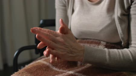 realizing : Old woman looking at her wrinkled hands, realizing her weakness and helplessness Stock Footage