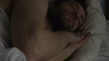obnovit : Calm bearded man sleeping in bed, breathing with open mouth, healthy sleep