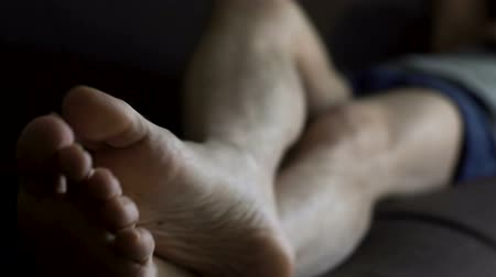 roto : Man in boxers sleeping on couch and scratching feet, skin problems and health