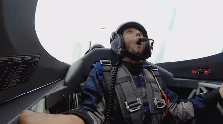 izlenim : View of happy male face, excited passenger of sports plane looking around. Stok Video