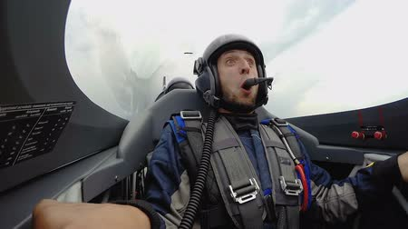eufória : Male passenger of flying sports plane shouting and smiling, extreme air sport