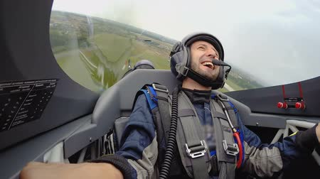 pilótafülke : View of happy impressed man sitting in jet plane with pilot, extreme tricks