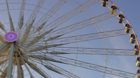 giant wheel : Big Wheel rotating, tourists in cabins watching cityscapes, rising over Paris