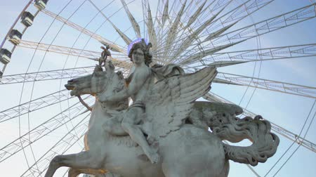 pegaz : Lighting halo around Pegasus Equestrian statue from Big Wheel working behind