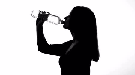 hidrasyon : Woman drinking water from bottle, healthy way of life, restoring ph balance Stok Video