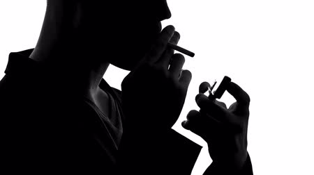 tabaco : Shadow of confident man lighting cigarette and smoking, unhealthy lifestyle Stock Footage