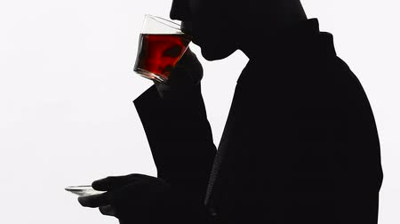 hidrasyon : Silhouette of male boss drinking tasty black tea during break, water balance