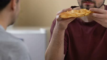 treating : Homosexual couple eating delicious pie for breakfast together, care and love Stock Footage