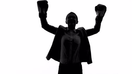 competitivo : Strong woman in boxing gloves raising hands, success and equal rights concept