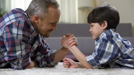 vasárnap : Caring dad praising his little son, fathers care and support, time together