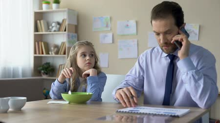 carelessness : Sad daughter talking to busy father ignoring her, lack of parental attention