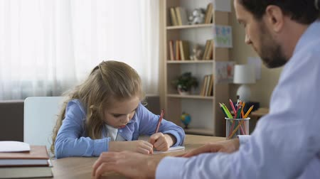confronto : Strict dad talking to daughter doing homework, parental control, education