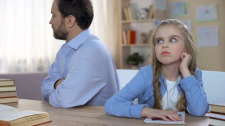 přestupek : Offended dad and kid sitting at table and keeping silent, conflict in family Dostupné videozáznamy
