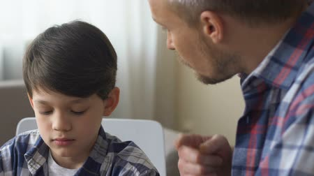 disobedient : Dad scolds his son for bad behavior, discusses child discipline.