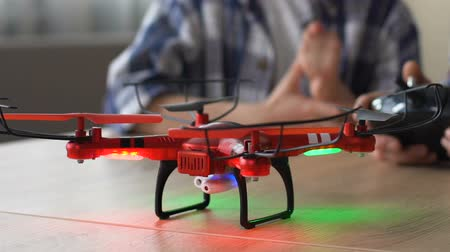 alıcı : Closeup of drone starting to fly, high-end technological toy for videography Stok Video