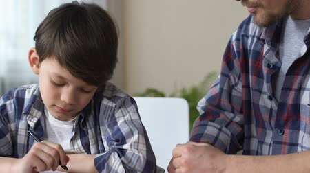 disobedient : Father scolds son, makes him to do homework, boy obediently begins to write.