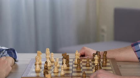 improve : Son playing chess with dad, giving high five, leisure time, happy together.