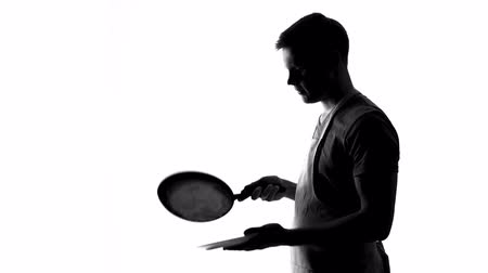panqueca : Male shadow putting pancake on plate and smiling, family breakfast cooking Stock Footage