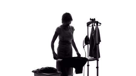 гладильный : Laundry service worker ironing customers clothes, hotel dry cleaning, housewife Стоковые видеозаписи