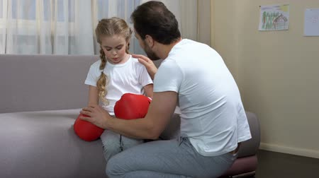 trusting : Dad calming down daughter after box game, trusting relationship, trainer support Stock Footage