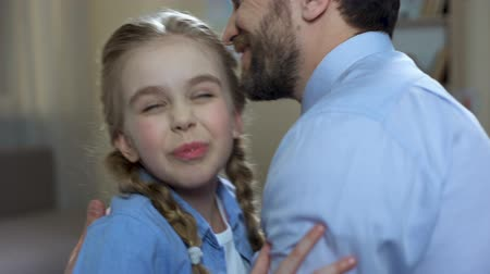 unconditional : Excited girl hugging father, family relationship, unconditional parent love