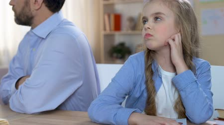 apologize : Father and daughter sitting turn away, feeling hurt, family quarrel, conflict Stock Footage