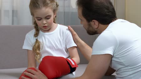 trusting : Father talking to daughter after box training, trusting relationship with child