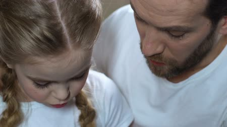 tavsiye : Loving father calming down sad daughter, spending time together. Stok Video
