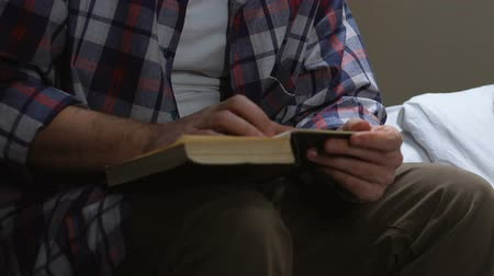 tutuklu : Male prisoner reading holy book in jail cell, searching for answers.
