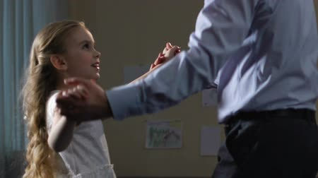 rehearsing : Daughter dancing with father at home, tender relations, spending time together.