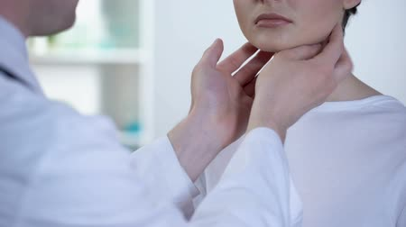 ormone : Professional doctor checking patient neck and examining glands during flu