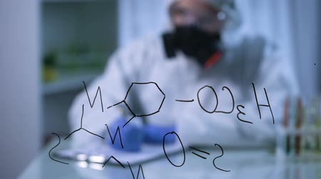 vzorec : Chemical formula on glass board, scientist in gas mask writing on background