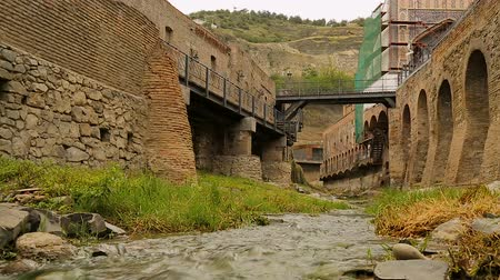 bathhouse : River between the fortress walls in Abanotubani ancient district of Tbilisi