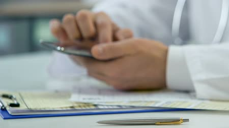 registrace : Hands of professional doctor scrolling on smartphone, consulting patient online