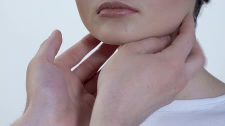 inflamed : Doctor examining woman lymph nodes, throat infection, patient consultation Stock Footage