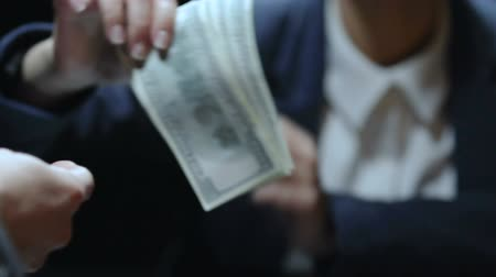 accepting : Lady taking dollar bills and putting pocket, bribery transaction, illegal salary Stock Footage