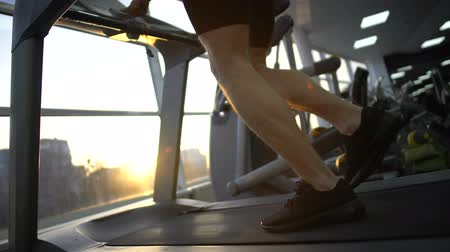 sportive : Athlete man running on treadmill in gym, warming up before workout, health