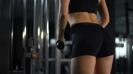 contra : Closeup of sportive female butts and sweaty back, woman tough workout in gym