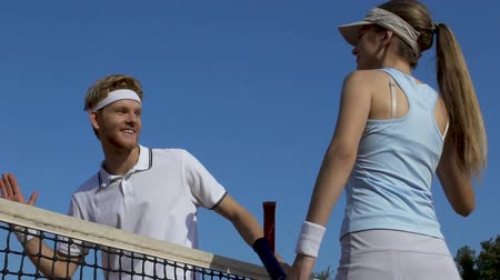 slapping : Tennis coach and woman beginner giving high five after good game, togetherness