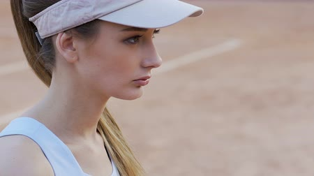seriously : Concentrated young tennis player staring rival before match, competitive spirit
