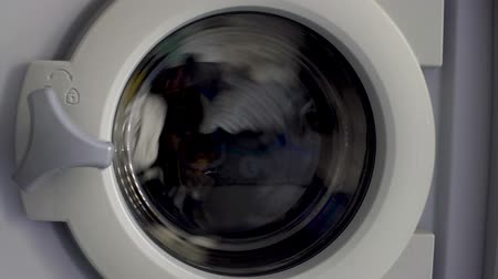 automatický : Washing machine cleaning clothes, laundry day at home, household appliance Dostupné videozáznamy