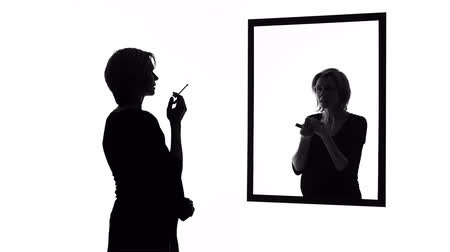 bad habits : Conscience-stricken pregnant woman smoking cigarette in front of mirror, habits Stock Footage