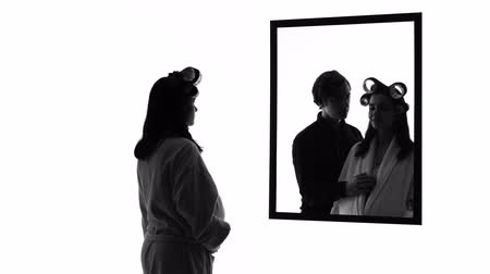 divorce : Pregnant depressed woman looking in mirror alone, imagining husband hugging her