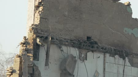 行為 : Close up of terrible destruction old building wall, history and war consequences