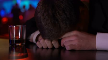 hangover : Drunk pub customer sleeping on bar counter, alcohol addict, depression problem