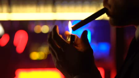 элита : Successful bachelor in suit lighting cigar, spending free time in strip club Стоковые видеозаписи